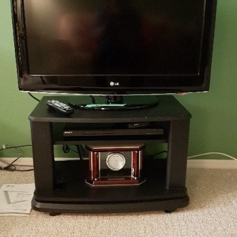 Downtown 109st condo  auction 11 LG TV DVD stand clock